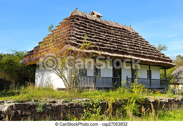 old farmhouse with a thatched roof - csp27053832