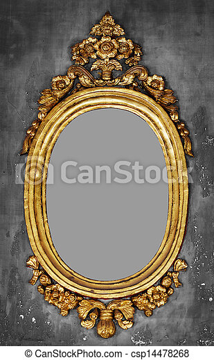 Old-fashioned gilt frame for a mirror on a concrete wall - csp14478268