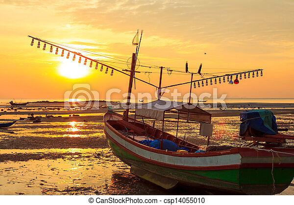 Old fishermans boat at sunset, during sea ebb - csp14055010