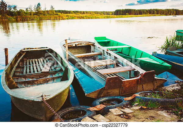 Old fishing boats in river rowboat belarusian nature old fishing boats in river csp22327779 publicscrutiny Image collections