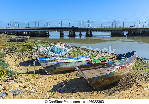Old fishing boats on the shore of a river - csp26922363