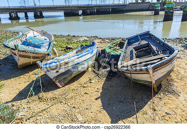 Old fishing boats on the shore of a river - csp26922366
