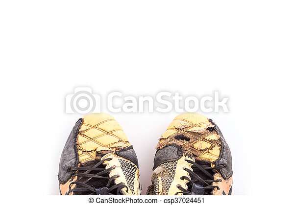 72fb0548c97 Old football shoes isolated on white background.