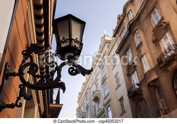 Old forged lantern on the wall - csp45053217