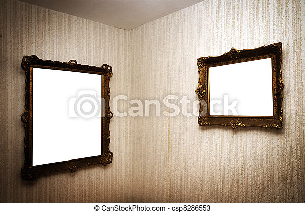 Old frames on retro wall. Old ornamented frames on retro grunge wall.
