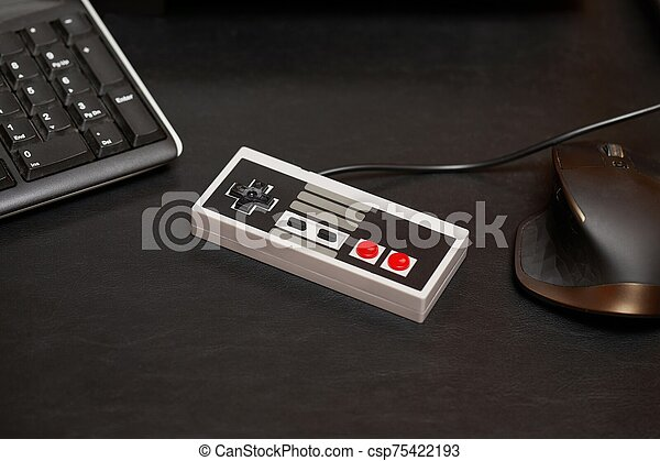 Old gaming console controller - csp75422193