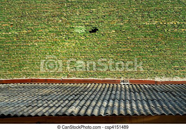 Old green bricks wall and shiver roof - csp4151489