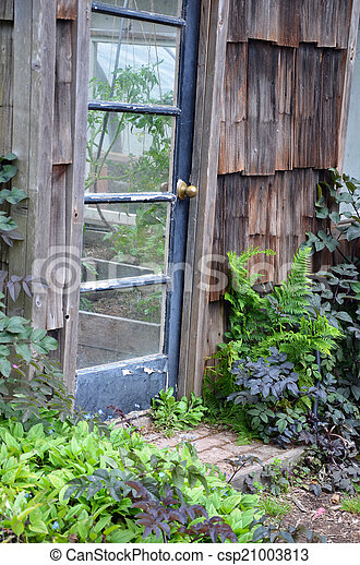 Old greenhouse door - csp21003813 & Old greenhouse door. Entrance to old wooden greenhouse stock ...