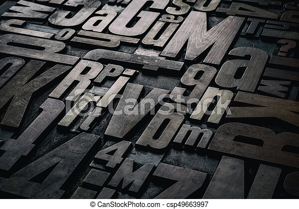 Old grungy letterpress wood type printing blocks - csp49663997