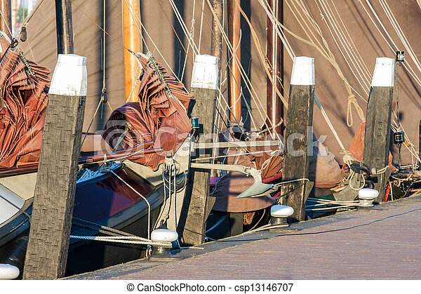 Old historic sailing ships in Dutch harbor of Urk - csp13146707