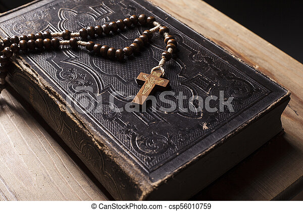 Old holy bible with rosary - csp56010759