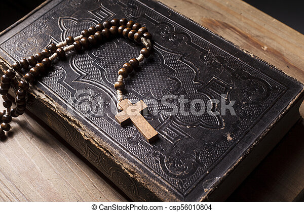Old holy bible with rosary - csp56010804