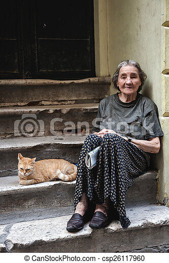 Old homeless woman in poverty. Old senior homeless woman ...