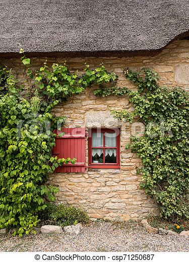 old house in saint lyphard with a thatched roof - csp71250687