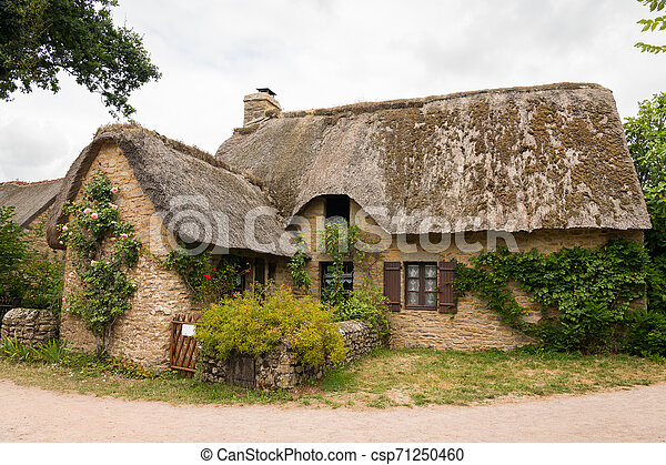 old house in saint lyphard with a thatched roof - csp71250460