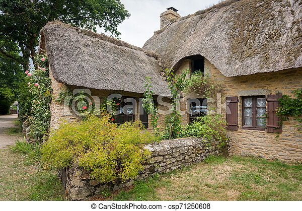 old house in saint lyphard with a thatched roof - csp71250608