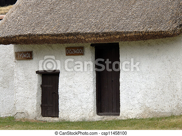 Old House Made Of Clay And Straw Roof With Small Doors