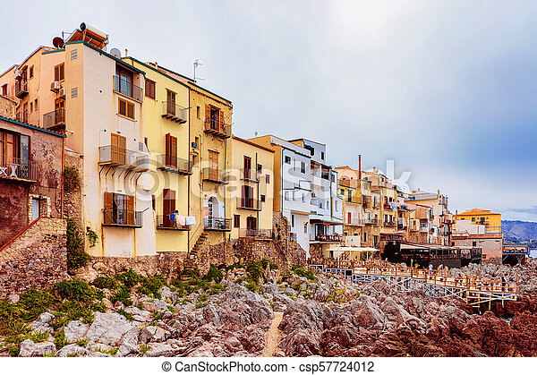 Old houses on rocky coast at cefalu sicily. Old houses on the rocky ...