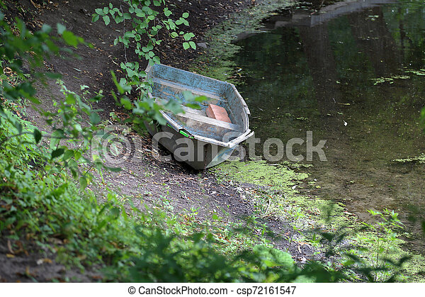 Old iron boat in the park in the afternoon - csp72161547