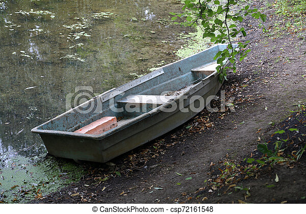 Old iron boat in the park in the afternoon - csp72161548