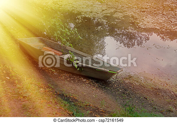 Old iron boat in the park in the afternoon - csp72161549