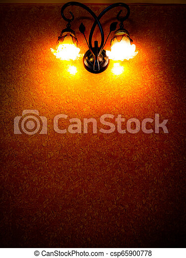 old isolated vintage old lamp on a wall - csp65900778