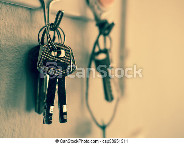 Old Key Vintage Hanging On Cement Wall Background