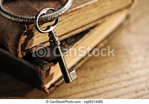 old keys on a old book - csp8314480