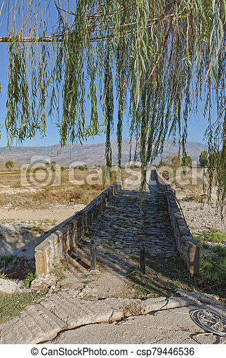 Old Kordhoce bridge from Ottoman period in Albania - csp79446536