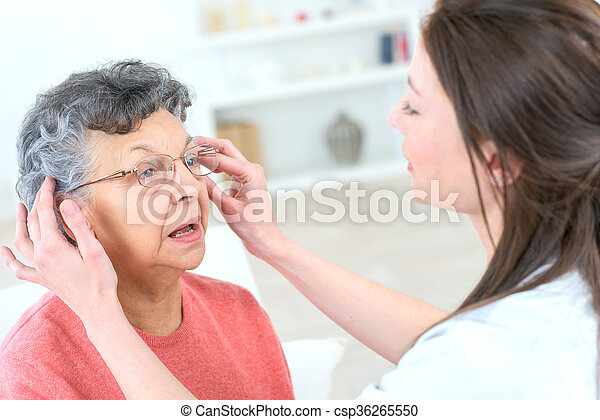 Old lady trying some glasses - csp36265550