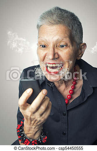 old lady yelling at her cell phone furious and frustrated old woman