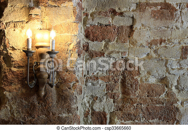 old lamp and cracked concrete vintage wall background - csp33665660