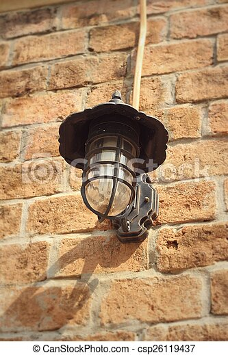 Old lamp brown brick wall. - csp26119437