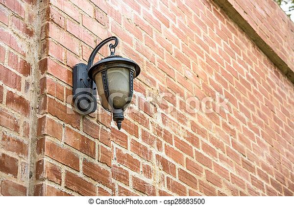 Old lamp on brick wall - csp28883500
