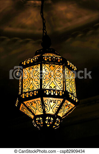 old lamp on the wall, photo as background - csp82909434