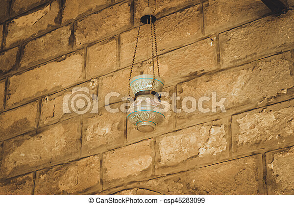 old lamp on wall at old mosque at cairo, egypt - csp45283099