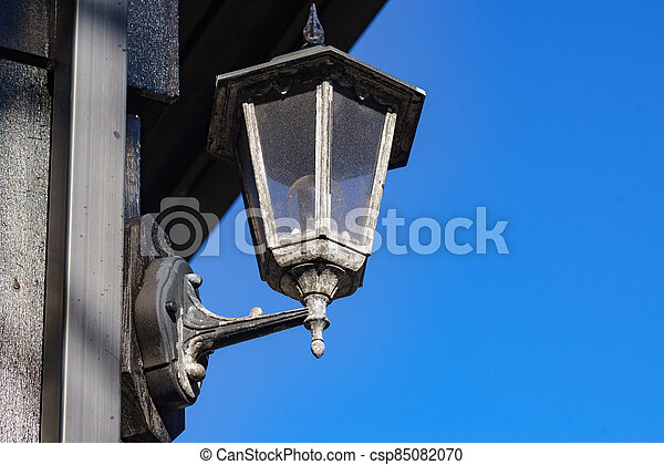 Old lamp on wall, street lantern outdoor - csp85082070