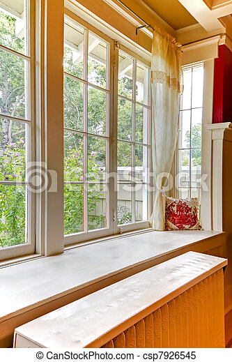 Old large window with heating water radiator. - csp7926545