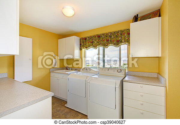 Old Laundry Room With White Cabinets And Yellow Walls Northwest Usa Canstock
