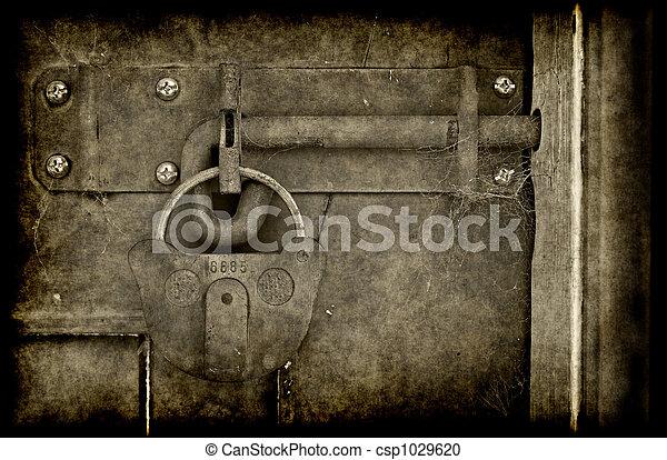 old locked door - csp1029620 & Old locked door. Big old lock keeps this door shut.