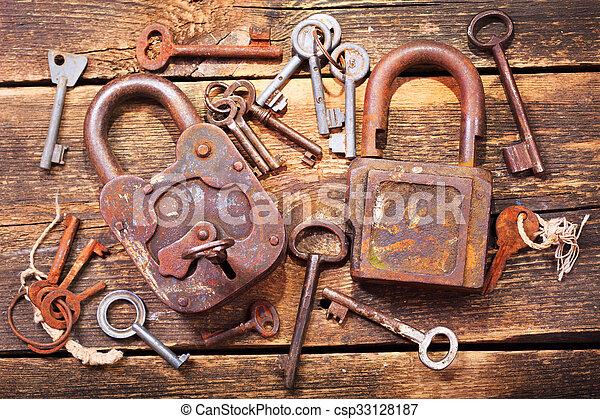 old locks and keys on wooden table old rusty locks and keys on