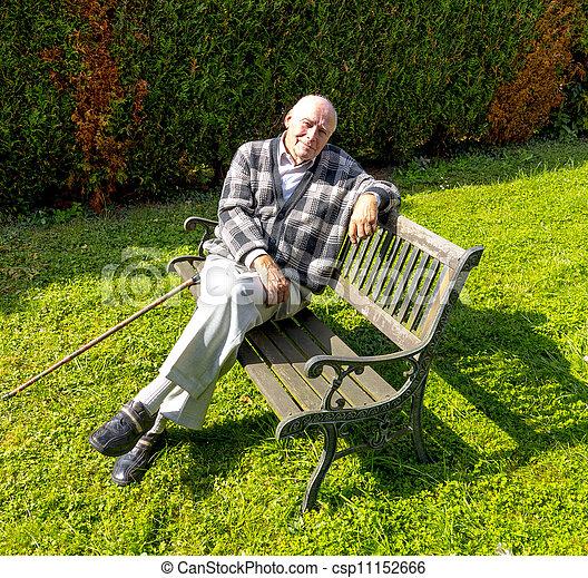 man enjoys sitting   bench   garden