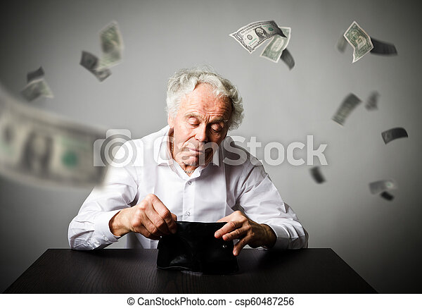 Old man in white and empty wallet. Accounting and taxes. Falling dollars. - csp60487256