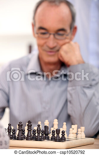 Old man playing chess - csp10520792