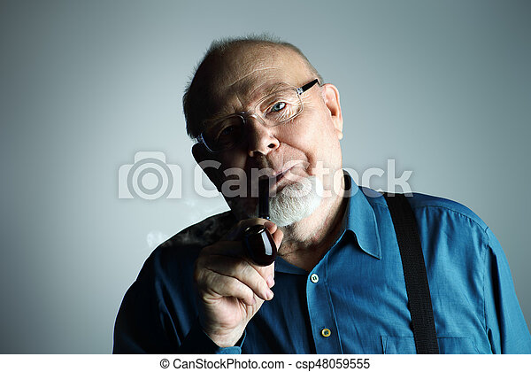 old man smoking a pipe - csp48059555