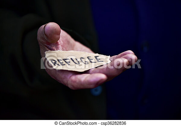 old man with a paper with the word refugee - csp36282836