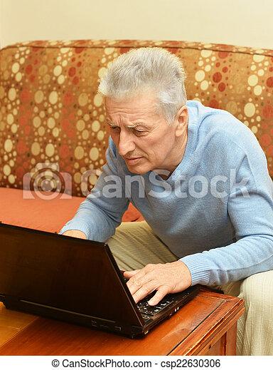 Old man with laptop - csp22630306