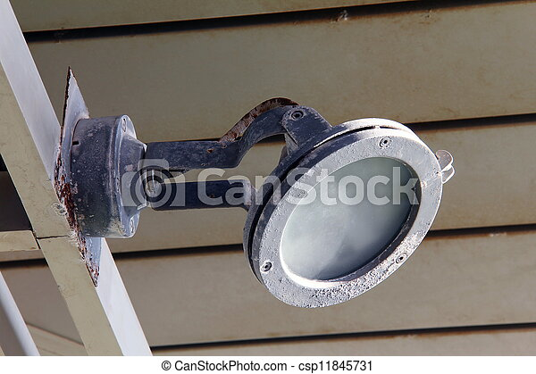 Old metal lamp on the wall - csp11845731