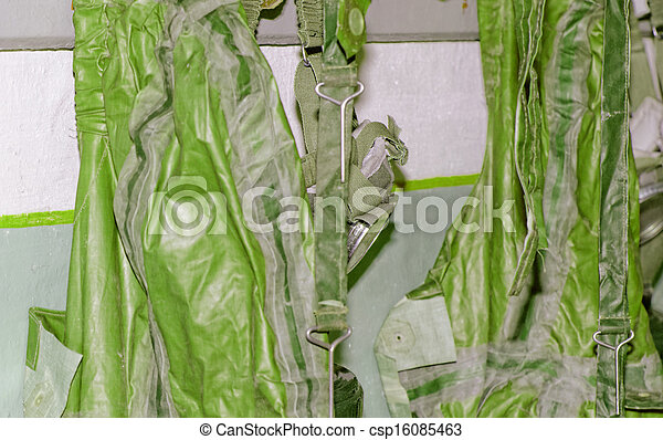 old military gas with a chemical protective suit green