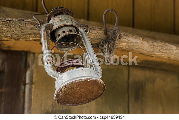 Old oil lamp on wooden wall - csp44659434
